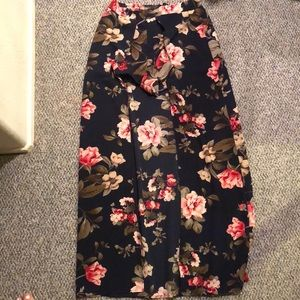 Open front long skirt with shorts. Floral.